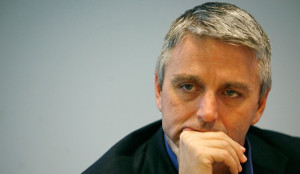 John Riccitiello looking sad: The best summation of 2012 we could think of.